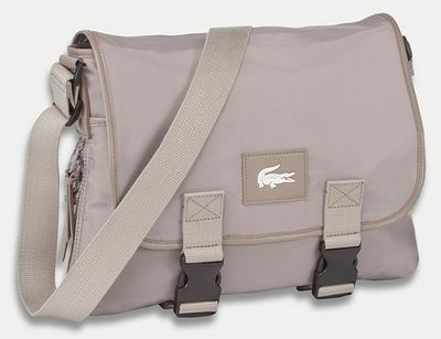 Give in to the charms of this Lacoste signature nylon computer bag.