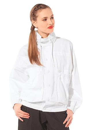 A mid-length blouson that can be either trench-coat or parka, with a belted ...
